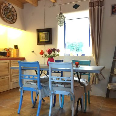 The dining table and inside kitchen.