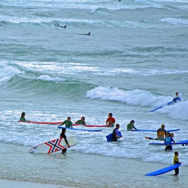 Surfers in the water at Peniche