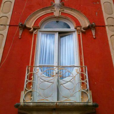 The elegant window of a house in Caldas da Rainha.