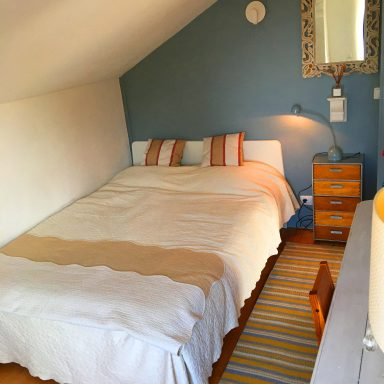 Smaller bedroom with a double bed.